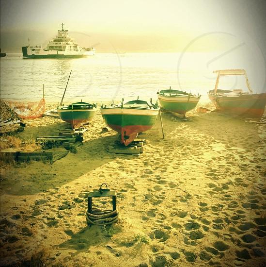 fishing boats on seaside photo