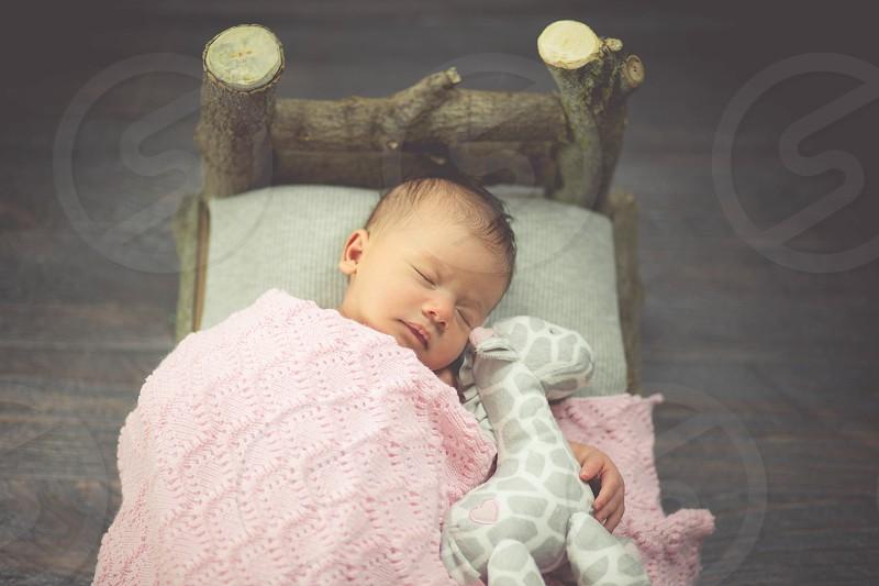 Newborn Baby on Wooden Bed photo