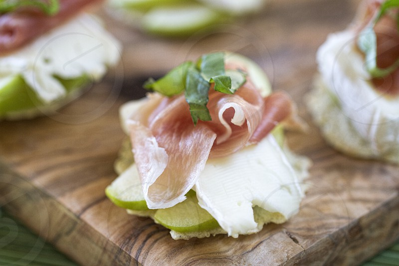 My Favorite Snack/Appetizer  - Brie Prosciutto Granny Smith Apples and Basil on Crackers photo