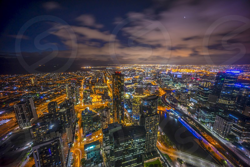 Aerial view of Melbourne city during dramatic blue hour dusk photo
