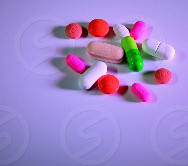 round oval pills with green capsules in the middle photo