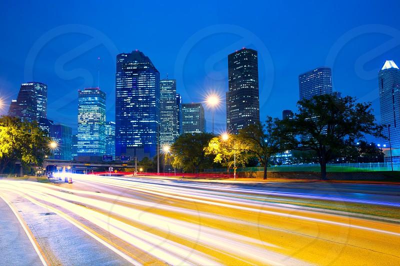 Houston Texas modern skyline at sunset twilight with traffic headlights lights trace photo