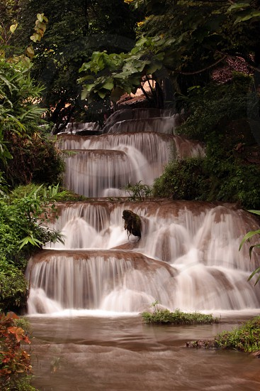 a waterfall in the Tropical Forest near the Village of Fang north of the city of chiang mai in the north of Thailand in Southeastasia. 
