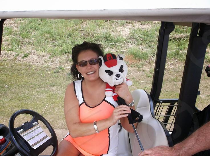 outside golf cart golf club woman happy photo
