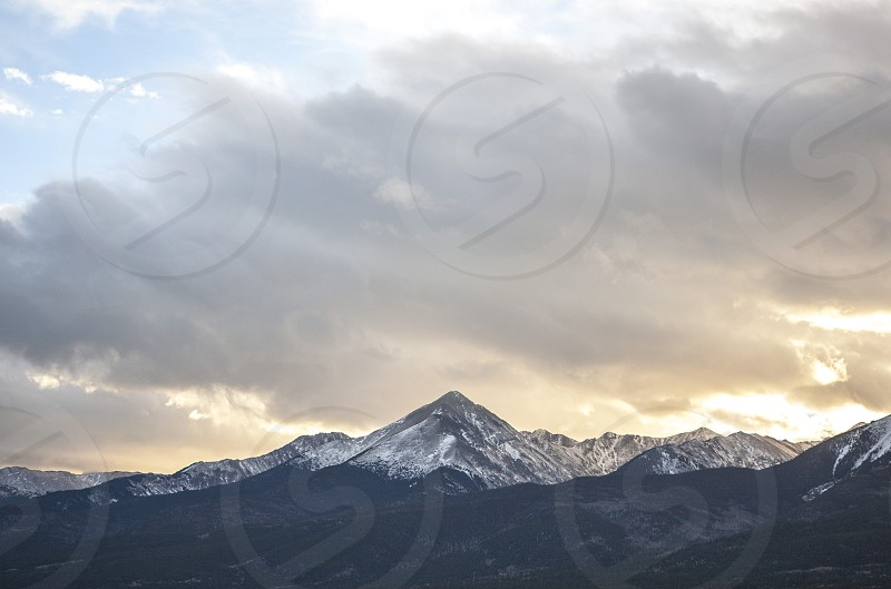 mountain peak sunset clouds breathe peace  photo