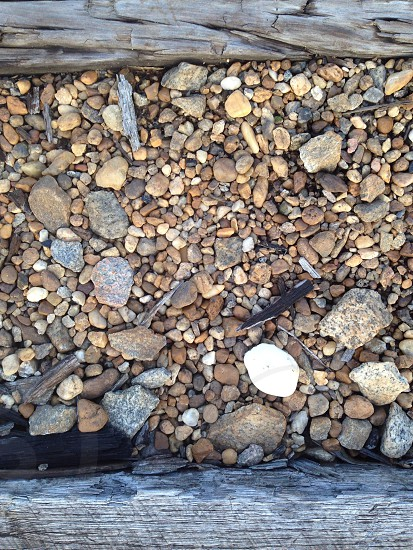 Unique one of a kind stand out stone pebble track train train tracks photo