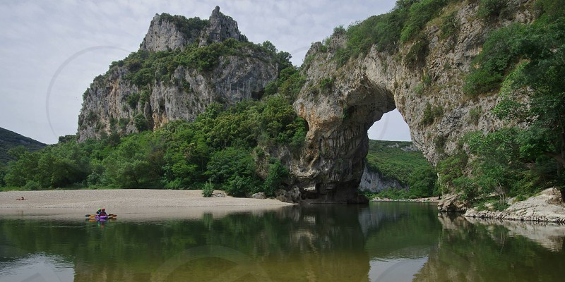 seashore view with rock arch photo