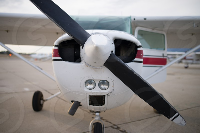 white and red propeller plane photo