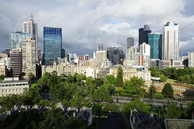 Parliament of Victoria against the backdrop of Melbourne central business district high rises - Melbourne City Center Australia  photo