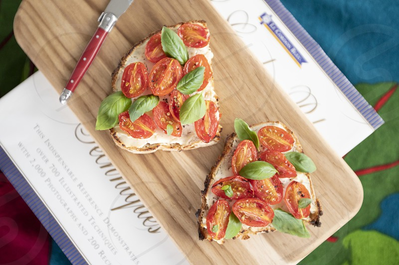 Country bread with ricotta cherry tomatoes and basil photo