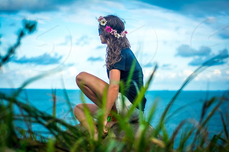 woman beautiful green blue sky flowers photo