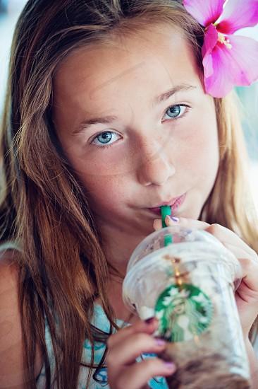 girl sipping starbucks coffee photo