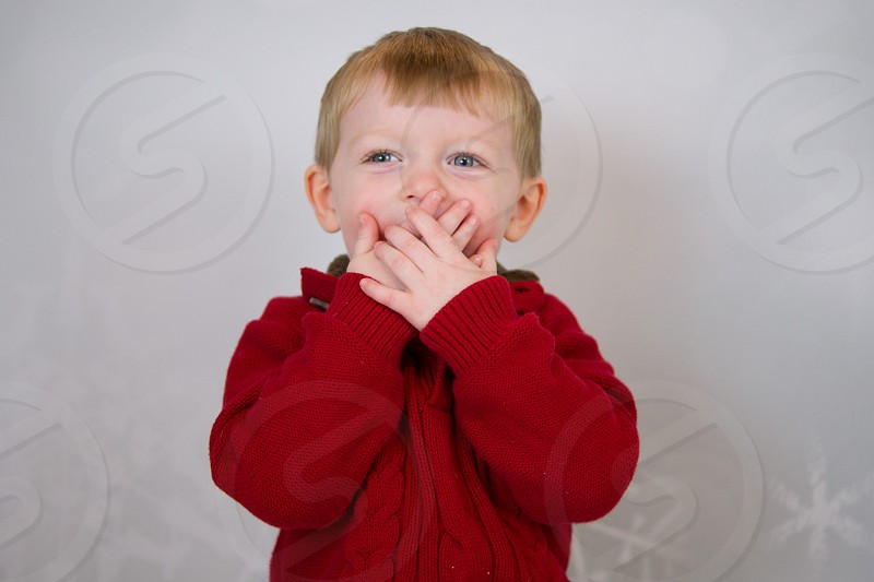 child in red sweater photo