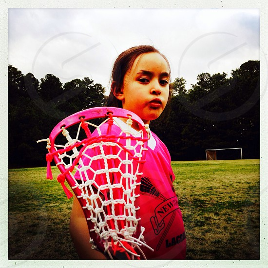 Little girl lacrosse player photo
