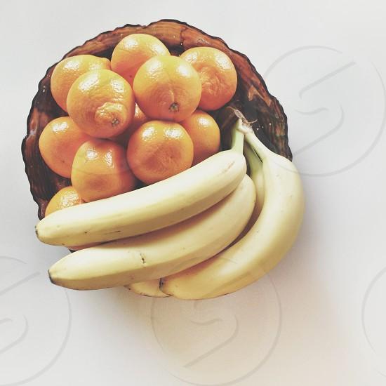 yellow banana and orange fruits on tray photo