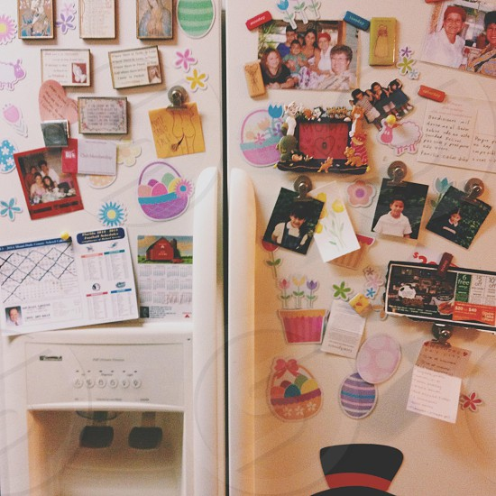 white fridge with photos photo