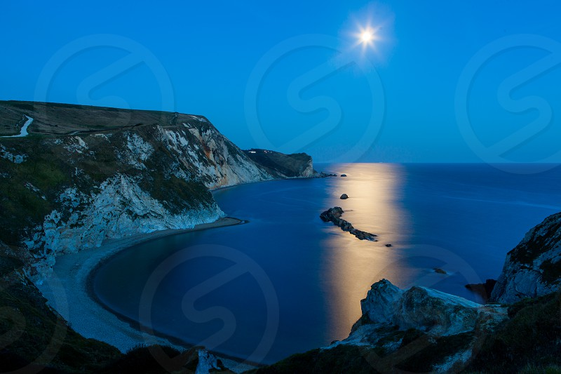 Lullworth CoveDorsetEnglandUKCoastmoon lightmoonreflectionnightcliffgeologicallocationtravelbluelong exposure photo