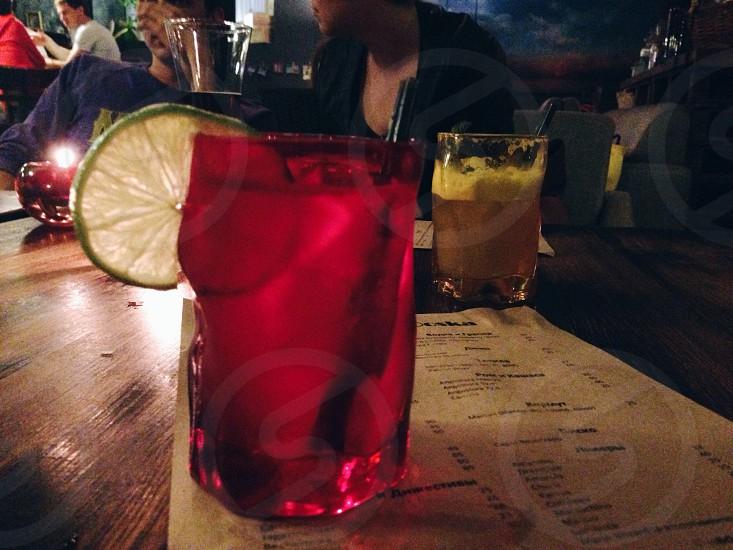 cocktails pink yellow glasses bar menu people talk  photo
