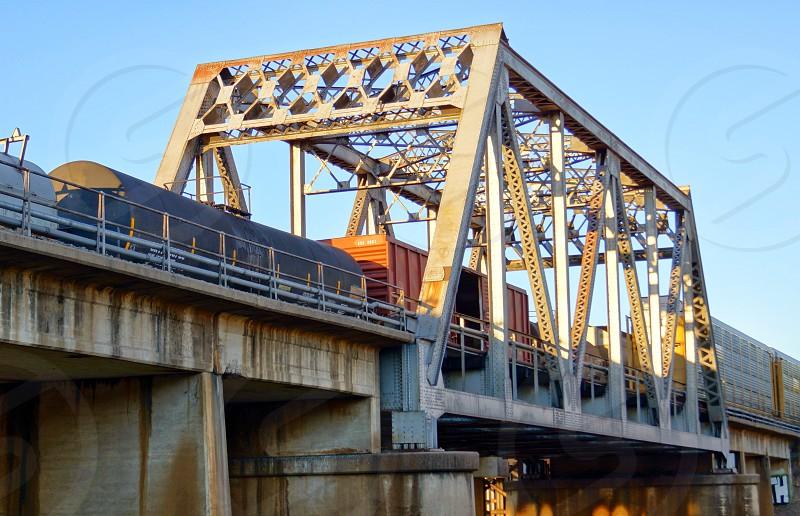 Railroad cars on bridge #transportation #railroad  photo