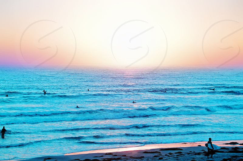 California beach sunset surfers photo