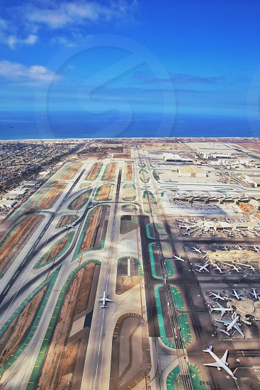 airport with runways and parked planes photo