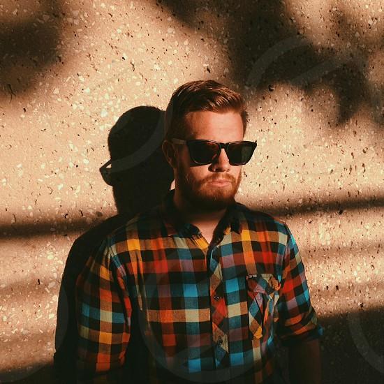 men's black framed sunglasses photo