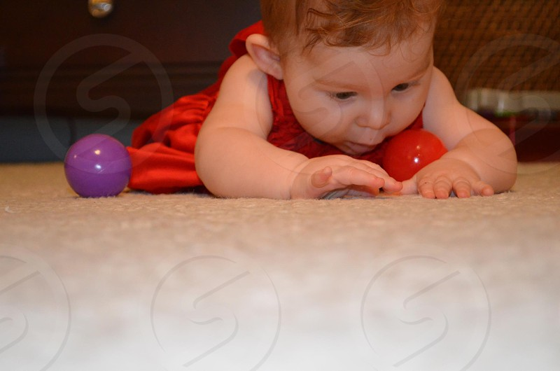 Baby playing with a ball. photo