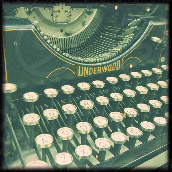 black and silver underwood typewriter photo