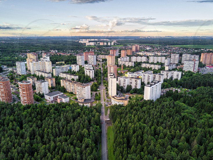 Aerial view on troitsk city and forest with road photo
