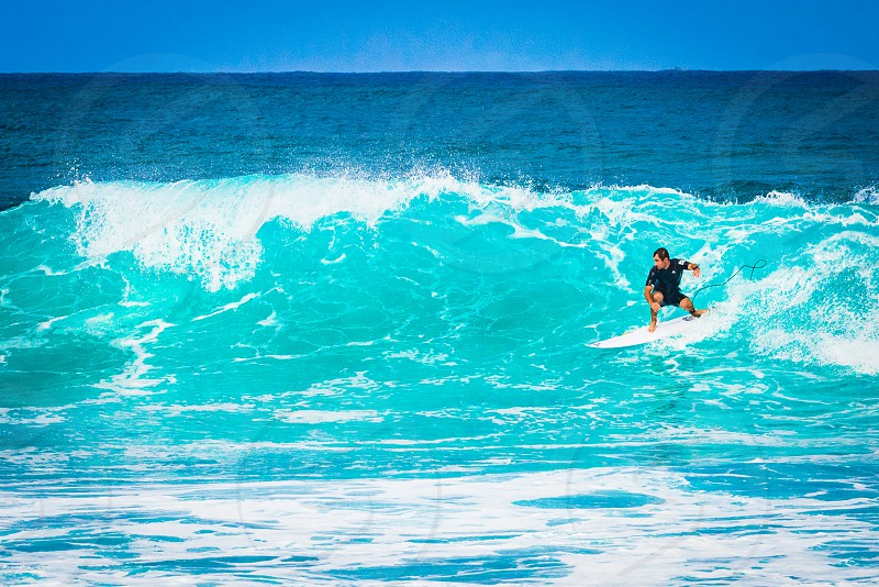 Surfer catching a big wave at North Shore Oahu Hawaii United States. photo
