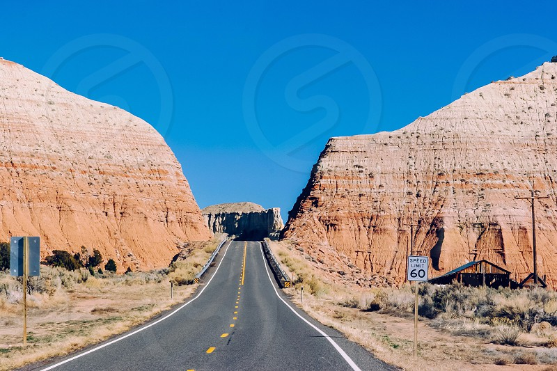 empty road and rock formation photography photo