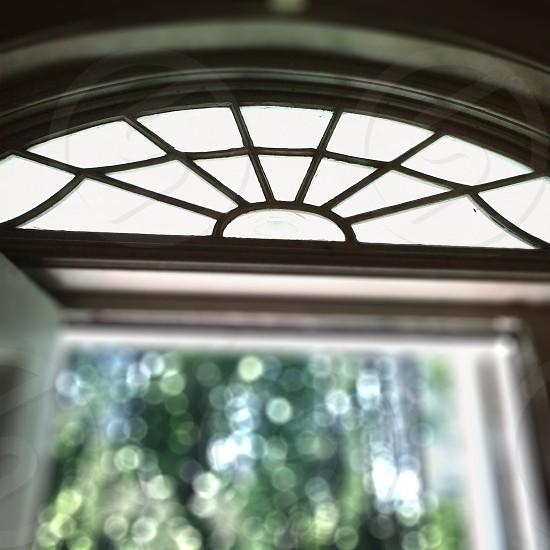 brown metal framed glass frame photo