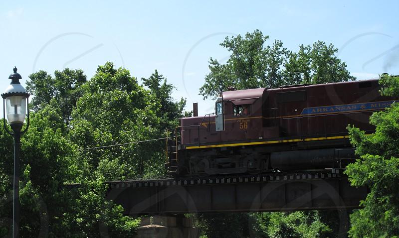 Arkansas & Missouri Railroad train engine bridge trees blue sky lamp post photo