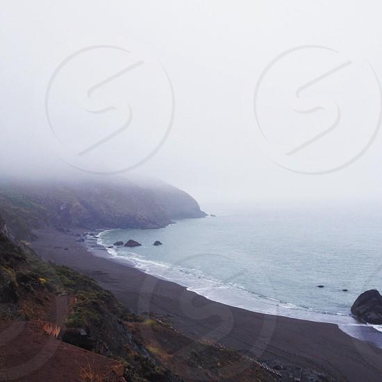 seashore and mountain mist view photo
