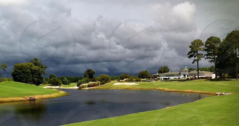 Golf course clouds storm water space photo
