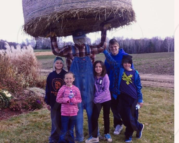 group of children near scarecrow photo