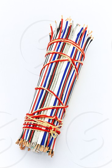 """Topic:""""Bundle of Wires"""" 2 This is an image of a bundle of electronic wires in multiple colors tied up with string with copy space and a clean white background. photo"""