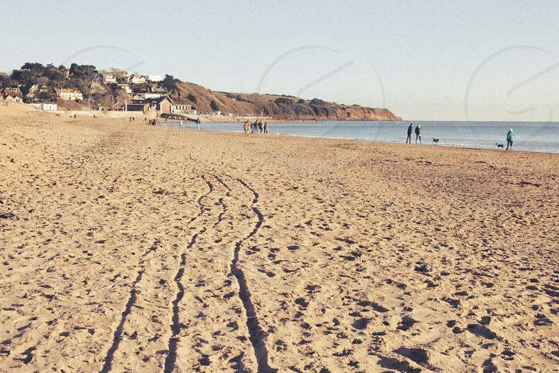 Tracks in the sand of Exmouth beach Devon UK. photo