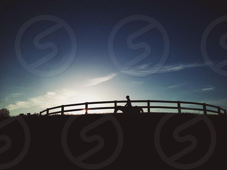 Sunset horse rider photo