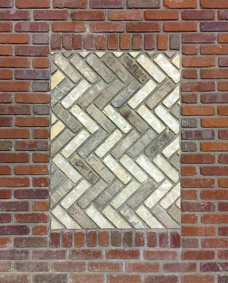 Brick wall pattern with inlay of diagonal bricks. #patterns #brick #red photo
