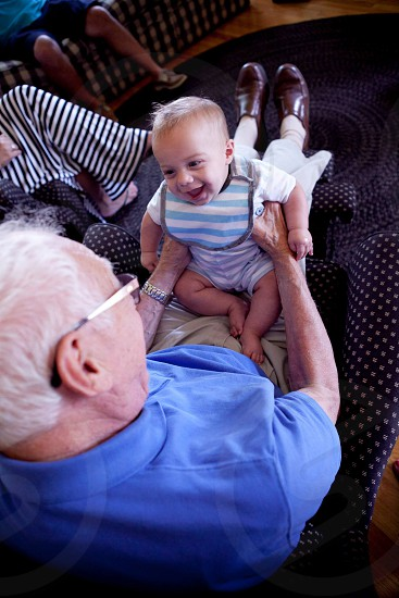 Grandpa and baby smiling photo