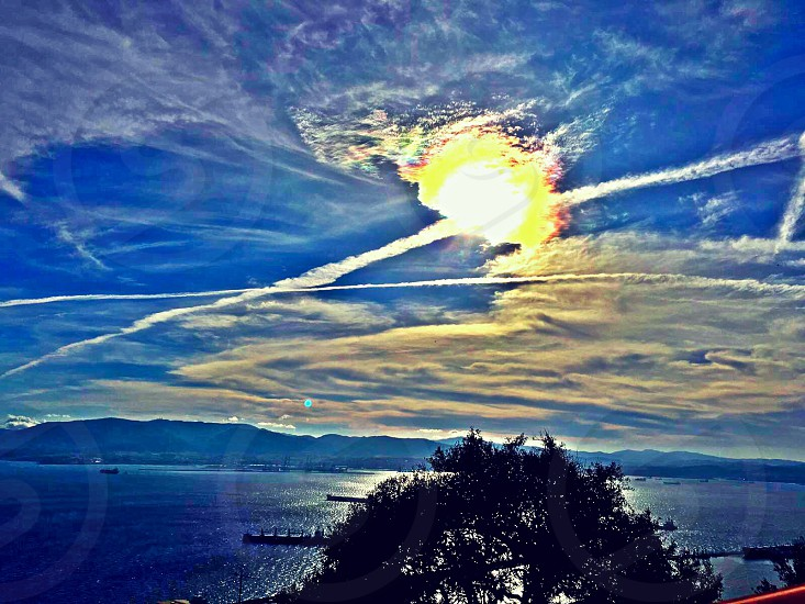 Skyclouds sea bay  trees mountain viewmorning ship  photo