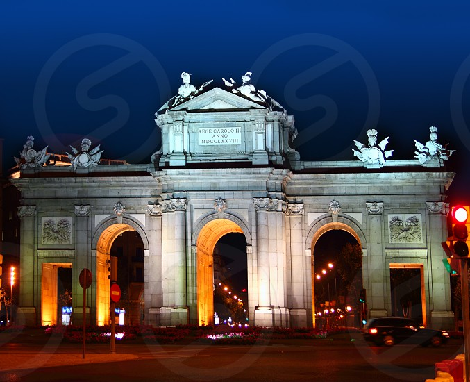 Alcala Puerta in Madrid with night lights in Spain photo
