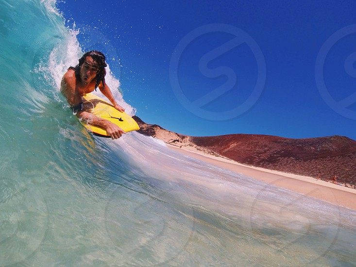 man on surf board surfing on a wave photo