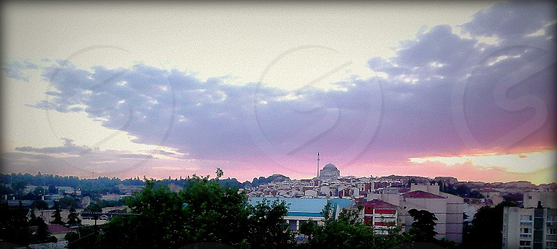 Sunrise in Turkey. Gazi Ahmet Pasa Mosque in Istanbul. Photographed from hotel room. photo