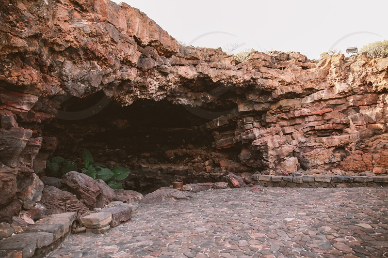 brown cave during daytime photo