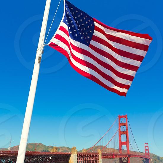 Golden Gate Bridge with United States flag in San Francisco California USA photo