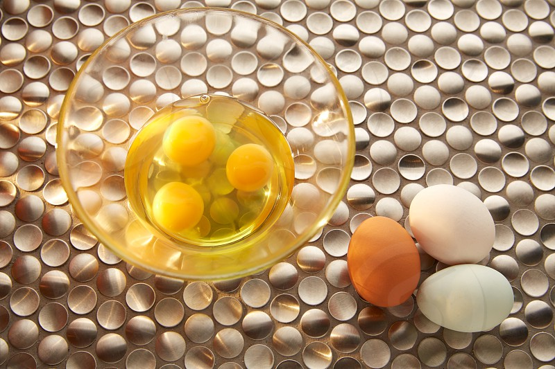 Eggs with blue easter white and brown egg colors on modern stainless steel photo
