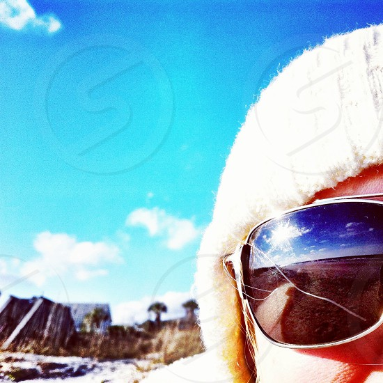Sunglasses on a cold beach day photo