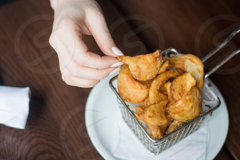 fried foods in stainless steel deep fryer basket photo